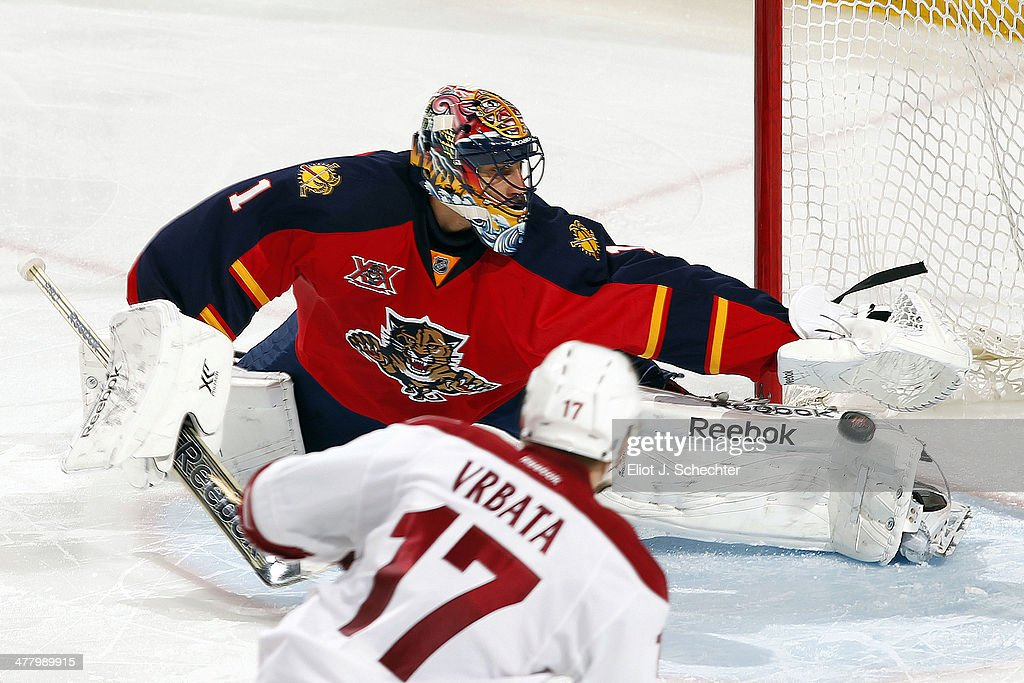 Radim Vrbata #17 of the Phoenix Coyotes shoots and scores a goal against goaltender Roberto Luongo #1 of the Florida Panthers at the BB&T Center on March 11, 2014 in Sunrise, Florida.