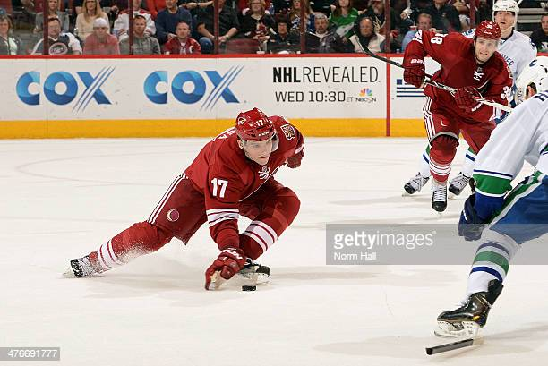Radim Vrbata of the Phoenix Coyotes uses his glove to stop the puck after breaking his stick against the Vancouver Canucks during the second period...