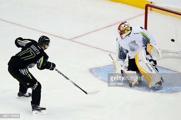 Radim Vrbata of the Vancouver Canucks and Team Foligno scores a first period goal past Roberto Luongo of the Florida Panthers and Team Toews during...