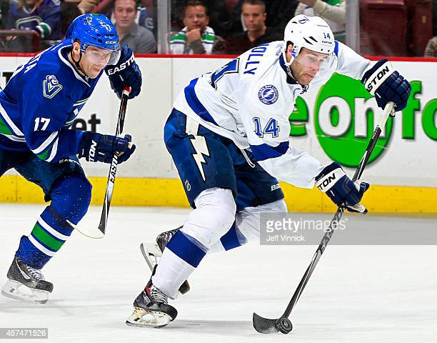 Radim Vrbata of the Vancouver Canucks skates after Brett Connolly of the Tampa Bay Lightning as he skates up ice with the puck during their NHL game...