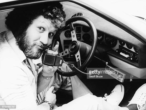Radio 1 disc jockey Dave Lee Travis pictured using his Fidelity CB 1000 FM radio from his car outside Eyeball Bistro Club in Princes Street London...