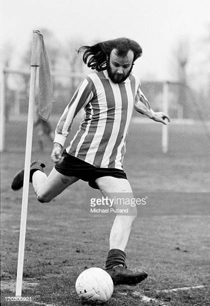 Radio 1 DJ John Peel takes a corner while playing a BBC football match UK 1971