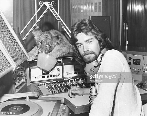 Radio 1 DJ Noel Edmonds in the radio studio recording his BBC breakfast show with Tiddles the lion cub as special guest Broadcasting House London...