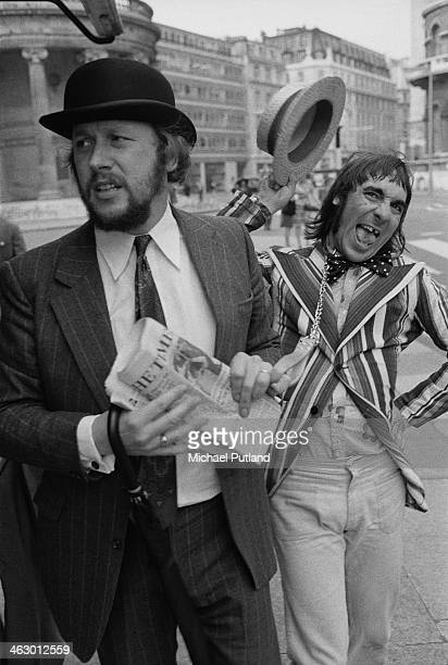 BBC Radio 1 producer and presenter John Walters in a city gent's outfit and drummer Keith Moon of The Who in a striped blazer and straw boater 11th...