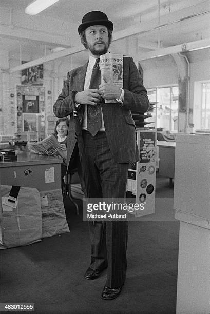 BBC Radio 1 producer and presenter John Walters wearing a city gent's outfit and carrying an umbrella and a copy of The Times 11th July 1973