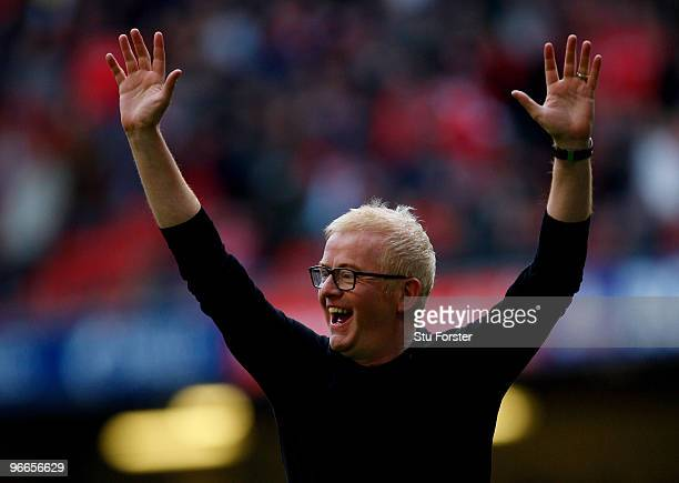 Radio 2 DJ Chris Evans celebrates after kicking a goal during a half time kicking competition during the RBS 6 Nations Championship match between...