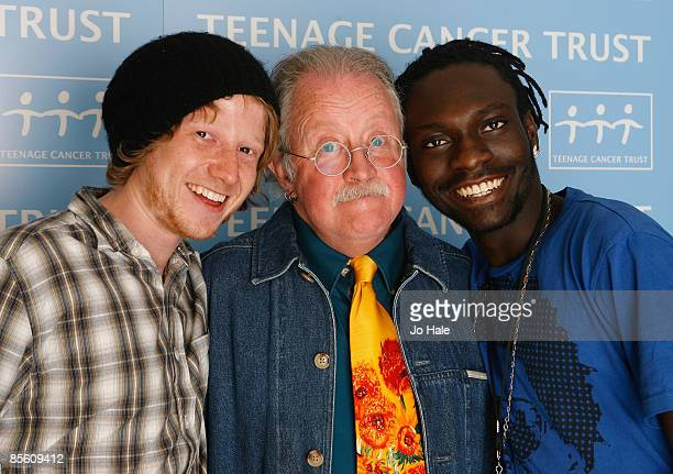 Radio 2 presenter Mike Harding poses backstage with TCT special guests Anthony Whitehead and Prince Aidoo during the second night of a series of...