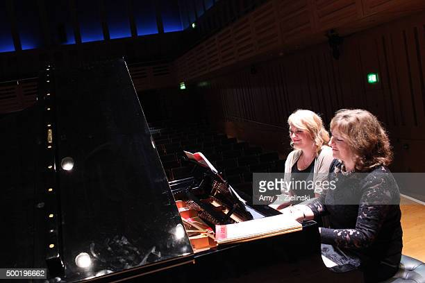 Radio 3 presenter Sarah Walker plays with concert pianist Lucy Parham during a rehearsal for 'Word And Play Celebrity Christmas Gala' at Kings Place...