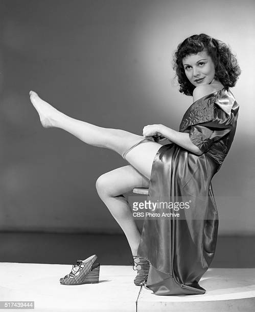 Radio actress Ruth Gilbert tries on nylon stockings and poses for glamour pictures New York NY Image dated May 3 1940