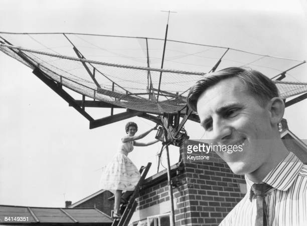 Radio amateur Peter Blair and his wife Eileen of Chaplin Close in Chelmsford Essex with the homemade dish aerial from which they bounced a morse code...