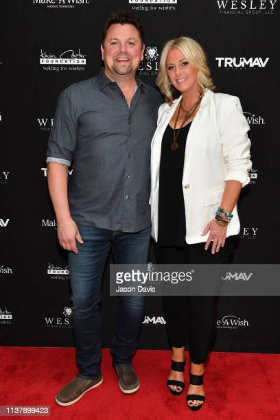 Radio and media personality Storme Warren and his wife Allison Warren arrive on the Red Carpet for the Waiting for Wishes Celebrity Waiters Dinner...