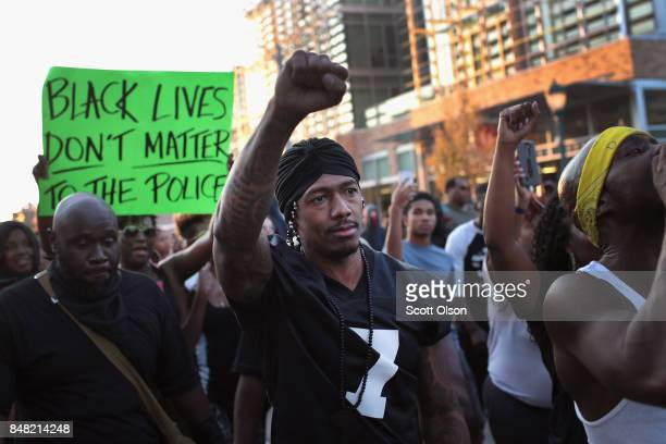 Radio and television personality Nick Cannon joins demonstrators protesting the acquittal of former St Louis police officer Jason Stockley on...