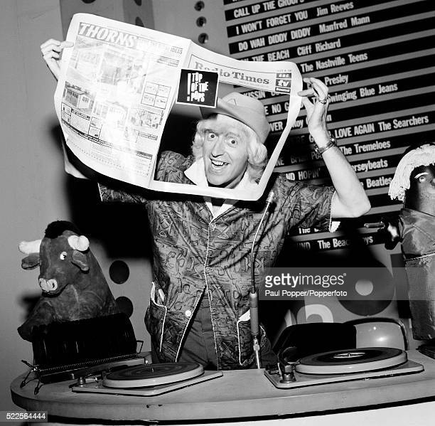 BBC radio and Television presenter Jimmy Savile putting himself on the cover of the Radio Times during a photocall at the Dickenson Road Studios in...