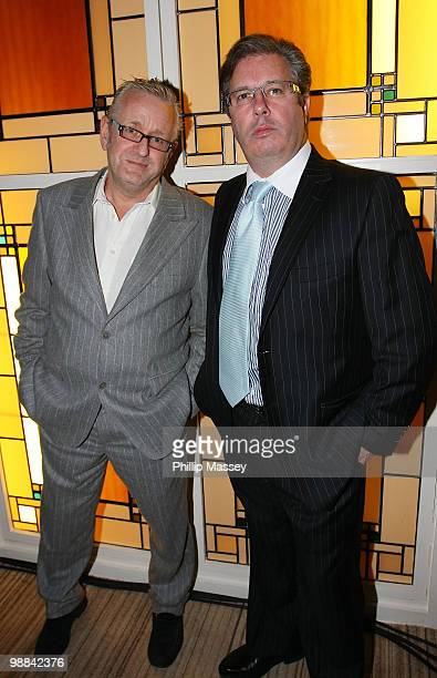 Radio and TV personality Gerry Ryan and artist Graham Knuttel attend the opening night of his exhibition in L'Ecrivain on November 4 2008 in Dublin...