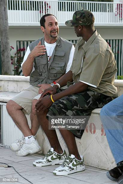 Radio announcer Eric Reid and Miami Heat guard Dwyane Wade talk at the 8th Annual Miami Heat Family Festival on March 20 2005 in Miami Beach Florida