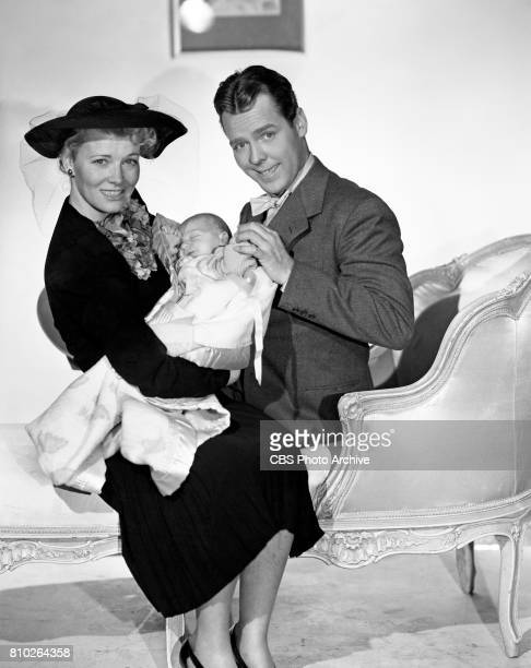 Radio characters Blondie and Dagwood pose for a photo with a new baby A contest is held to help name the baby girl She is named Cookie Image dated...