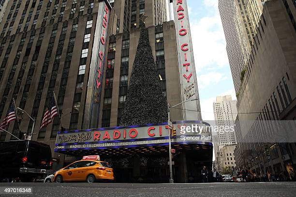 Radio City Music Hall stands in Midtown Manhattan as people lineup for the first showing of the annual Radio City Christmas Spectacular on November...
