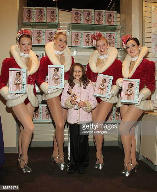 Radio City Rockettes Corinne Tighe Jill Wolins Jessica Pack and Sagan Rose with Emily Fox 9 yrs old from Connecticut attend the launch of Madame...