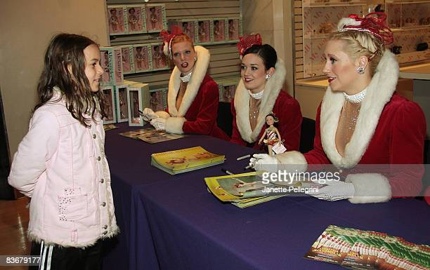 Radio City Rockettes Jessica Pack Sagan Rose and Jill Wolins with Emily Fox 9 yrs old from Connecticut attend the launch of Madame Alexander's Candy...