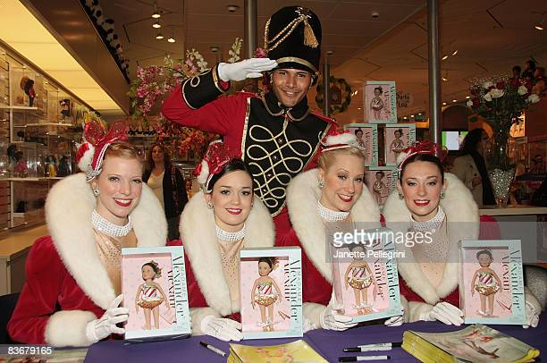 Radio City Rockettes Jessica Pack Sagan Rose Jill Wolins and Corinne Tighe with FAO Schwarz Soldier Micha Feliciano attend the launch of Madame...