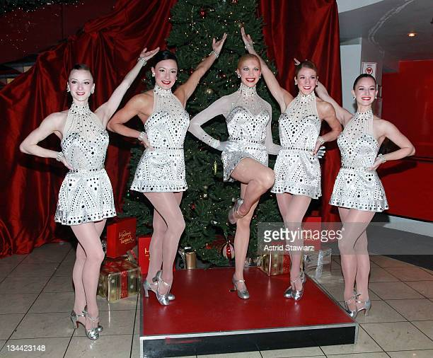 Radio City Rockettes Karen Ritchie Traci Reszetylo Taylor Shimko and Christina Cichra pose for photos with the 2011 Rockette wax figure at Madame...