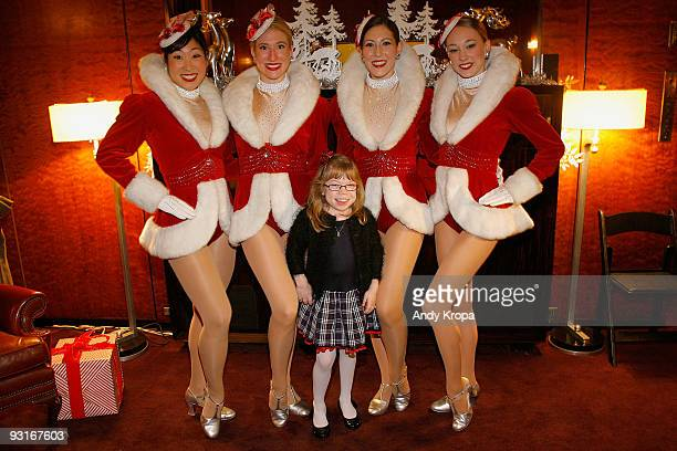 Radio City Rockettes Lisa Matsuoka Laura Danelski Alyssa Epstein and Miki Berg greet elevenyearold Alena Galan a child given assistance by the Garden...