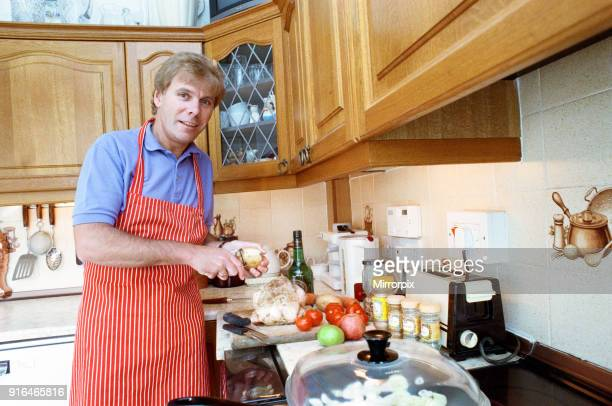 BBC Radio Cleveland presenter Colin Bunyan preparing a meal in his kitchen 1st November 1991