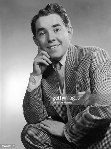 Radio comedian Ronnie Corbett posing with his finger on his cheek, circa 1955.