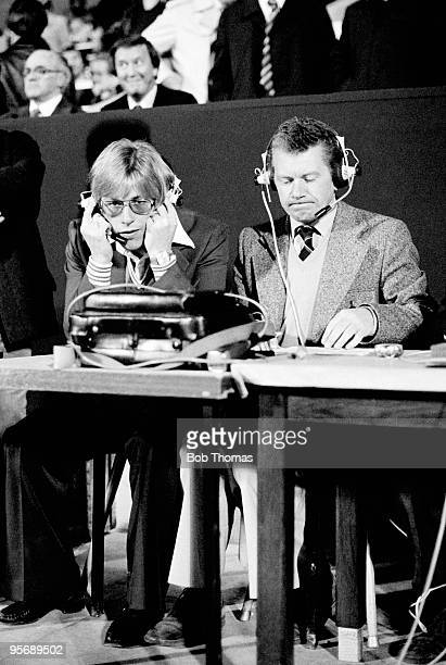 BBC Radio commentator Bryan Butler with Manchester United defender Brian Greenhoff watching the World Cup Qualifying match between Luxembourg and...