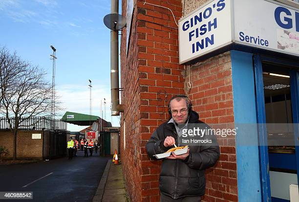 BBC radio commentator Ian Dennis eats fish and chips before the FA Cup third round match between Blyth Spartans and Birmingham City at Croft Park on...