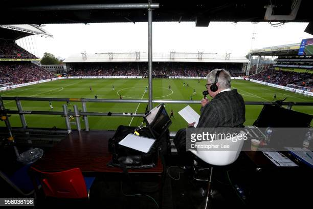 Radio commentator John Motson watches over the pitch during the Premier League match between Crystal Palace and West Bromwich Albion at Selhurst Park...