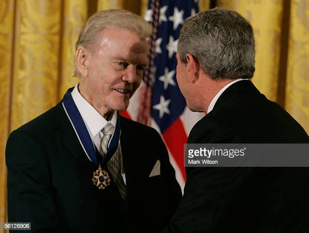 Radio commentator Paul Harvey is congratulated by US President George W Bush after recieving the Medal of Freedom during a ceremony at the White...