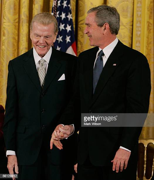Radio commentator Paul Harvey stands with US President George W Bush before recieving the Medal of Freedom during a ceremony at the White House...