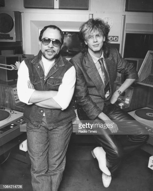 Radio disc jockey Andy Peebles pictured in the studio with musician John Taylor bassist for the band 'Duran Duran' May 1984