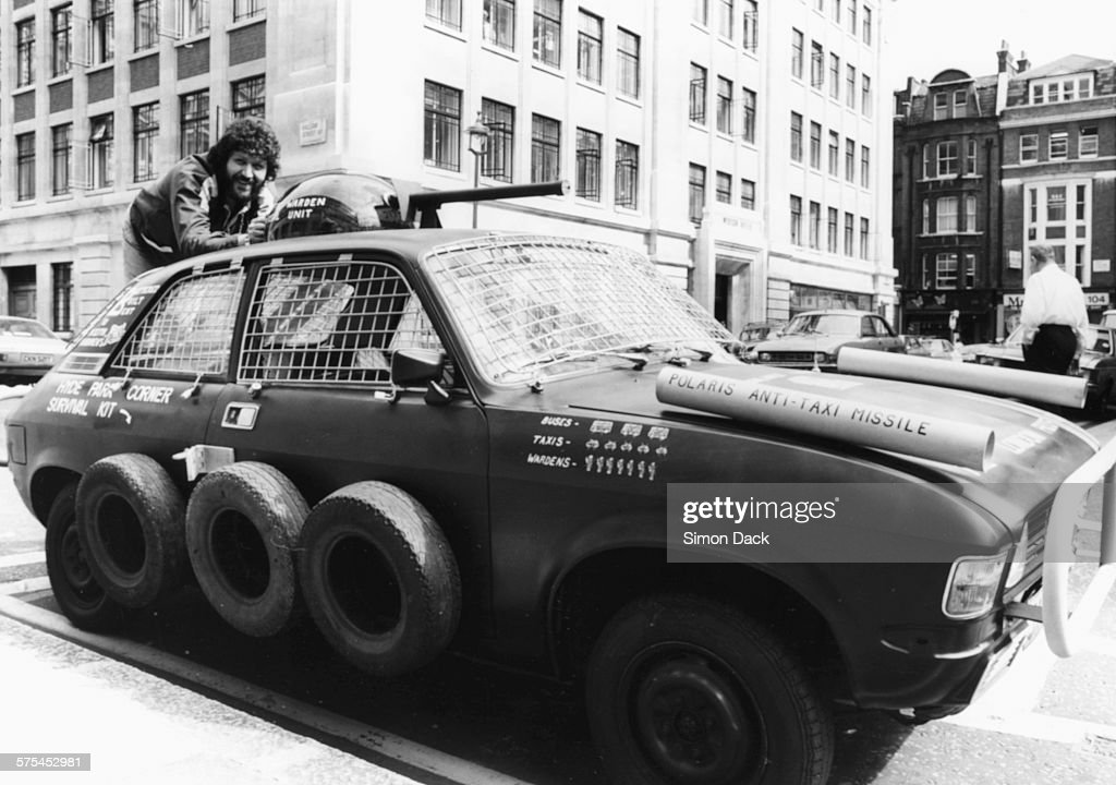 Radio Disc Jockey Dave Lee Travis Demonstrating His London Proof Car With Wire