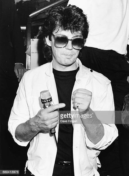 Radio disc jockey Mike Read posing with his 'Blue Peter' bade at the Hippodrome in London circa 1987