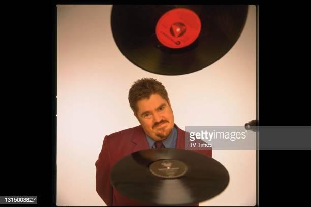 Radio disc jockey turned television presenter, comedian Phil Jupitas.Circa 2000.