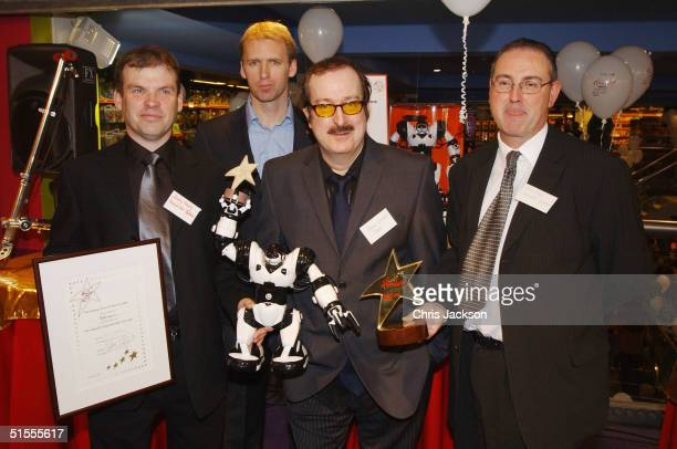 Radio DJ Steve Wright appears with the judging panel and Robosapien a representative after presenting the prize for Toy of the Year at Hamelys...