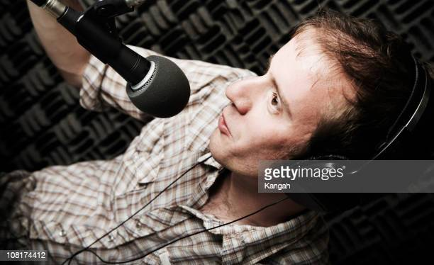 Radio DJ Talking into Microphone
