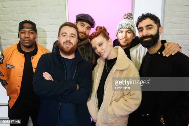 Radio DJ Tom Green stands with English singer Jess Glynne and DJ Locksmith Piers Aggett Kesi Dryden and Amir Amor of UK group Rudimental as they...