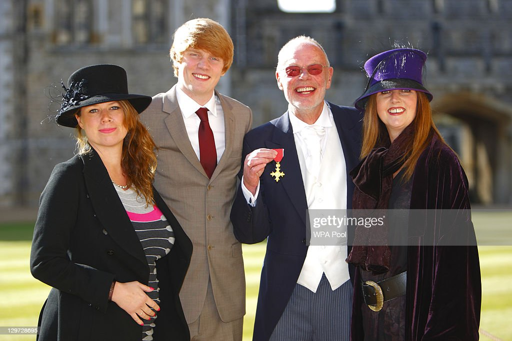 Radio DJ 'Whispering' Bob Harris poses with his wife Trudie Myerscough-Harris (R) and children Charlie Harris and Miles Myerscough-Harris after receiving his Officer of the British Empire (OBE) from the Princess Anne, Princess Royal at Windsor Castle on October 20, 2011 in Windsor, England.