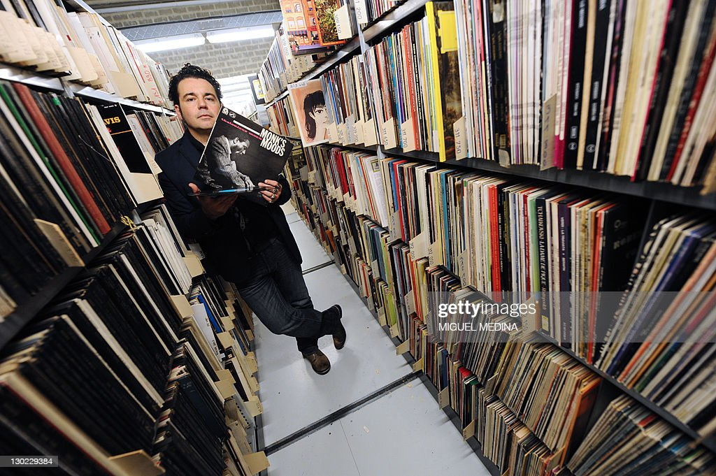 Radio France music library head Marc Maret poses with a vinyl LP on October 19, 2011 in Paris at the music library of the public media group Radio France.