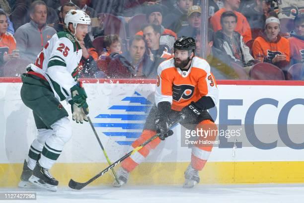 Radio Gudas of the Philadelphia Flyers and Jonas Brodin of the Minnesota Wild skate at Wells Fargo Center on January 14 2019 in Philadelphia...