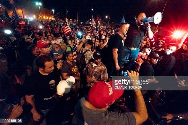 """Radio host and conspiracy theorist Alex Jones shouts """"America is Awake"""" and speaks to Trump supporters gathered in front of the Maricopa County..."""