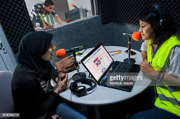Radio host Ayo interviews Issraa Murabit after she voted on July 7th 2012 in one of Tripoli's english language stations Tripoli FM After 42 years of...