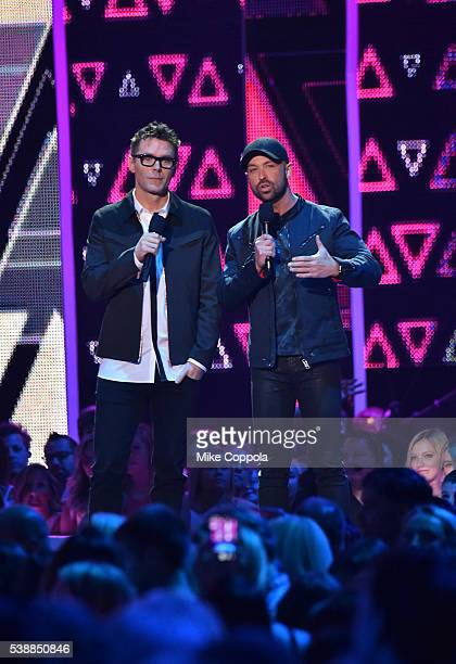 Radio host Bobby Bones and CMT's Cody Alan onstage during the 2016 CMT Music awards at the Bridgestone Arena on June 8 2016 in Nashville Tennessee