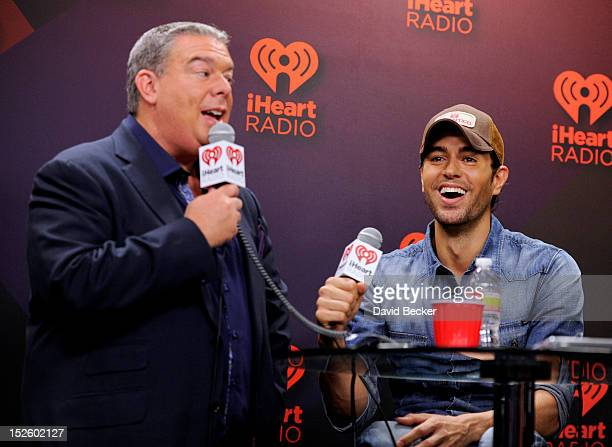 Radio host Elvis Duran and singer Enrique Iglesias in the Elvis Duran Broadcast Room during the 2012 iHeartRadio Music Festival at the MGM Grand...