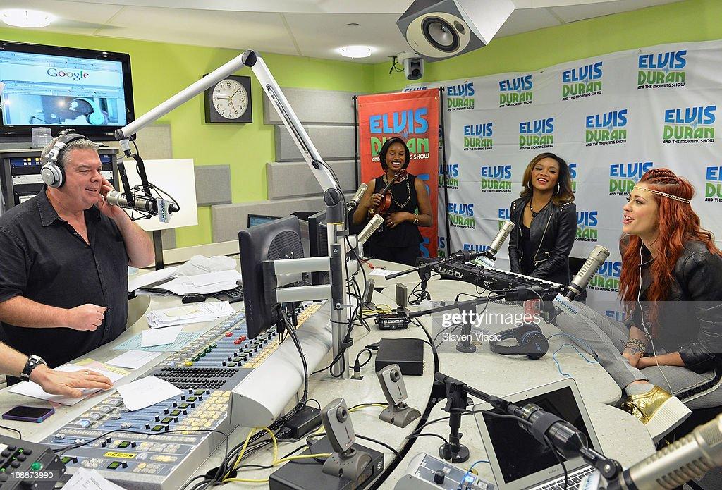 Radio host Elvis Duran (L) interviews singer Nikki Williams (R) at Elvis Duran Z100 Morning Show at Z100 Studio on May 16, 2013 in New York City.