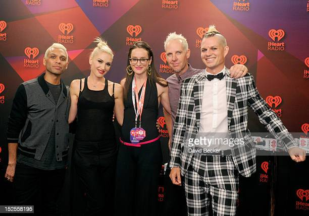 Radio host Kennedy poses with bassist Tony Kanal, singer Gwen Stefani, guitarist Tom Dumont and drummer Adrian Young of No Doubt in the Elvis Duran...