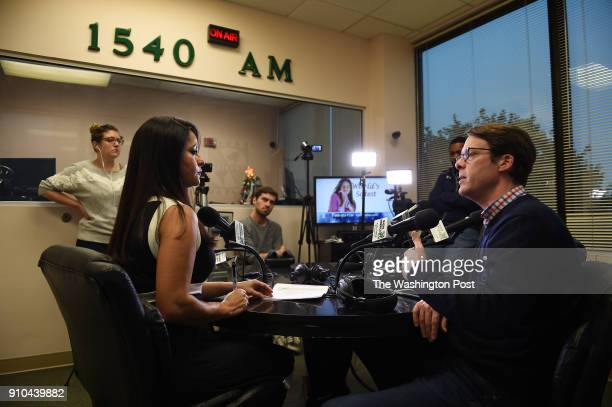 Radio host Lilian Mass left talks to Hans Riemer right President of the Montgomery County Council during a live radio show at Radio America WACA...
